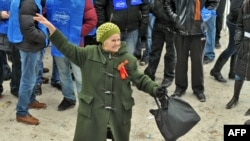 An elderly supporter of Viktor Yanukovych dances as she celebrates the election results during a rally in front of the Central Election Commision in Kyiv today.