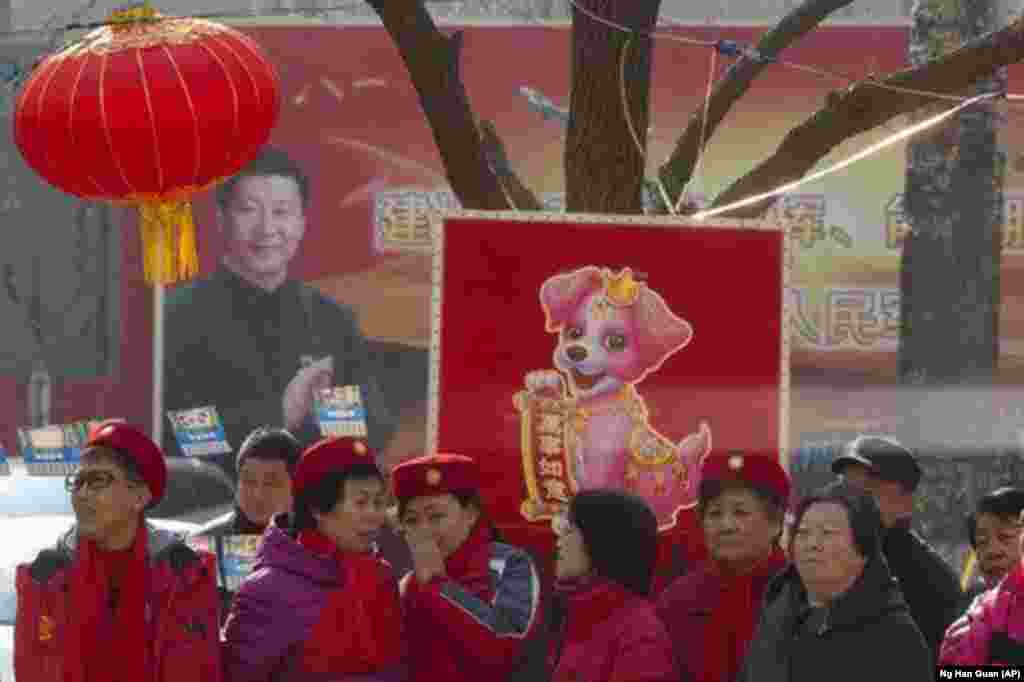 Билборд на улице Пекина с изображением Си Цзиньпина.