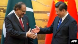 Pakistani President Mamnoon Hussain (left) attends a signing ceremony with Chinese President Xi Jinping in Beijing on February 19.