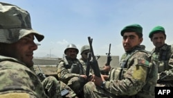 Afghan soldiers arrive at the gate of an international military compound in Kabul.