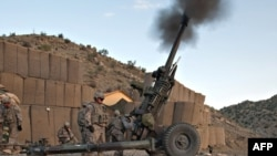Troops fire an artillery field gun in Paktia Province, where heavy fighting has been reported in recent days.