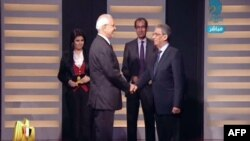 Amer Musa dhe Abdel Moneim Abol Fotuh