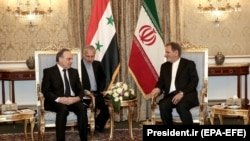 Iranian First Vice-President Es'haq Jahangiri (R) and Syrian Prime Minister Imad Khamis attend a meeting in Tehran, January 13, 2020.