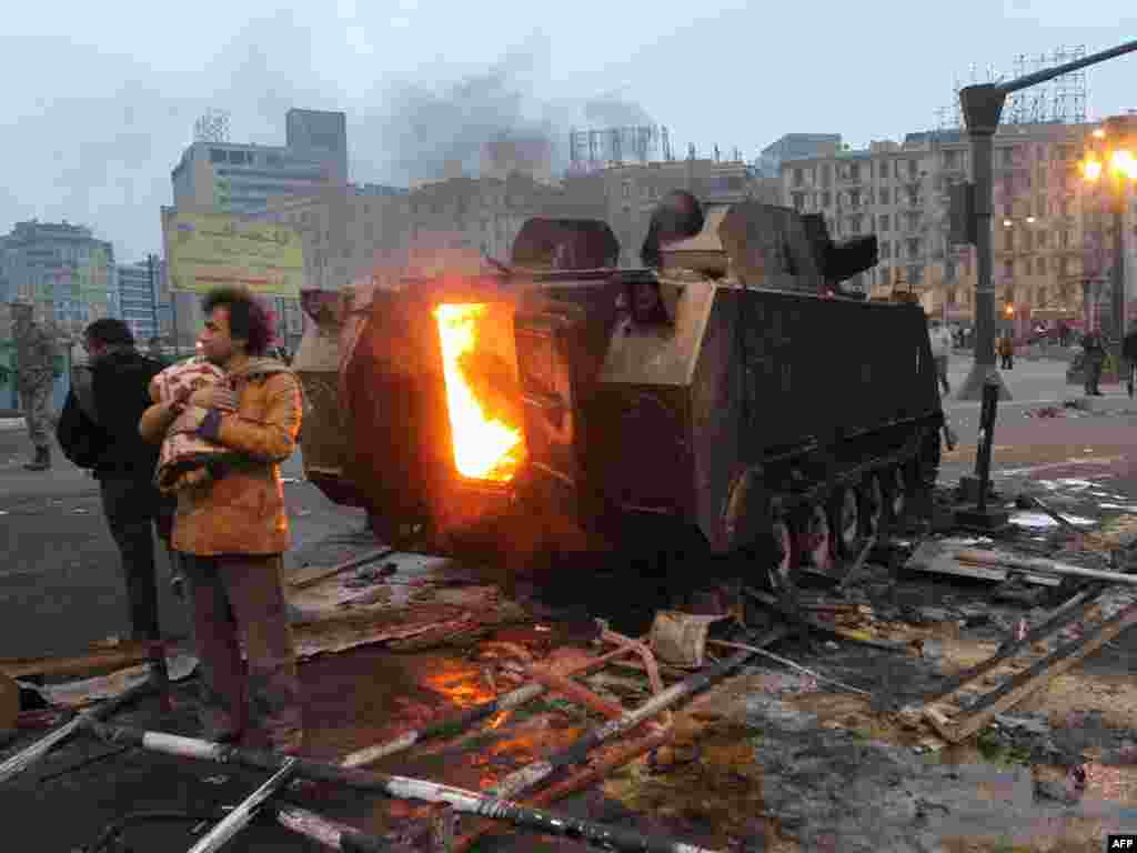 A burning armored vehicle in central Cairo on January 29.