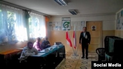 Представитель Меджлиса крымско-татарского народа наблюдает за президентскими выборами в Польше. 10.05.2015