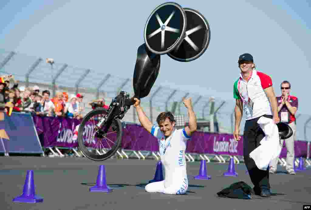 Italy's Alessandro Zanardi -- a former Formula 1 race driver -- celebrates after winning the gold medal in the men's individual H4 time trial cycling final.