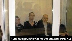 Обвинувачені зліва направо: Лев Просвірнін, Дмитро Рева, Віктор Сукачов, Віталій Федоряк (грудень 2012)
