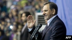 Iranian Vice President Eshaq Jahangiri waives to the crowd as he attends a campaign rally for the presidential election in Tehran on May 13.