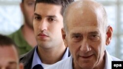 Ehud Olmert (right), seen here in custody in 2009, served as Israel's prime minister from 2006 to 2008.