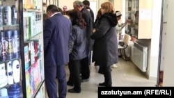 Customers line up for medicine at a Yerevan pharmacy on February 28, 2018.