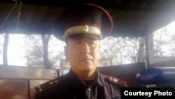 Police officer Aibek Eshbaev was found dead in prison.