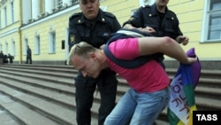 A gay activist is detained by police during a gay-pride parade in St. Petersburg in June 2011.