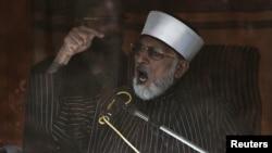 Pakistanly ruhany Muhammad Tahir-ul-Kadri tarapdarlarynyň öňünde çykyş edýär, Yslamabat, 15-nji ýanwar, 2013.