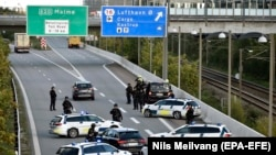 DENMARK -- Police vehicles block the street leading to the Oeresund Bridge near Copenhagen, September 28, 2018
