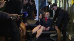 Couched In Defiance: Russian Activist Carried From Electoral Office Amid Crackdown