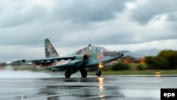 A Russian Sukhoi Su-25 fighter jet takes off from the Russian Hmeimim air base in Syria.