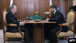 When the two men met at the Kremlin this week, Russian President Vladimir Putin (left) announced that Chechen leader Ramzan Kadyrov (right) would continue as acting head of the Caucasus republic once his current term of office expires in April.