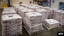 Ооганстандан Австралияга келген жүктөн табылган 97.7 кило героин жана 118.4 кило псевдоэфедрин.