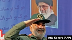 IRAN -- Iranian Revolutionary Guards commander Major General Hossein Salami salutes the crowd during a pro-government rally on central Enghelab Square in Tehran, November 25, 2019