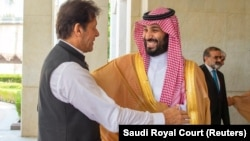 FILE: Pakistani Prime Minister Imran Khan is welcomed by Saudi Arabia's Crown Prince Mohammed bin Salman in Jeddah on September 19.
