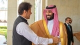 Pakistani Prime Minister Imran Khan (left) is welcomed by Saudi Crown Prince Muhammad bin Salman in Jeddah in September 2019.