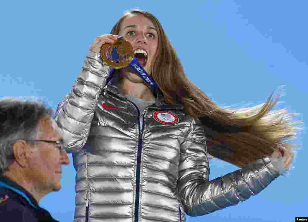 Gold-medallist Maddie Bowman of the United States celebrates during the victory ceremony for the women's freestyle-skiing halfpipe. (Reuters/Shamil Zhumatov)