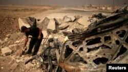 Ostaci automobila bombaša samoubice IDIL-a u Mosulu
