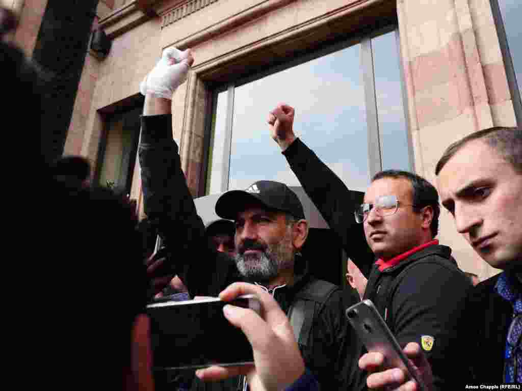 Opposition leader Nikol Pashinian emerges from the Marriott Hotel in Yerevan after meeting with Prime Minister Serzh Sarkisian on April 22.