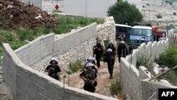 Policia shqiptare në Lazarat gjatë aksionit në muajin qershor të vitit 2014