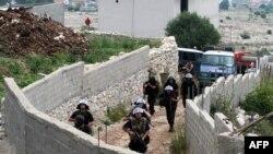 Pamje nga operacioni i policisë së Shqipërisë në fshatin Lazarat në qershor të vitit 2014