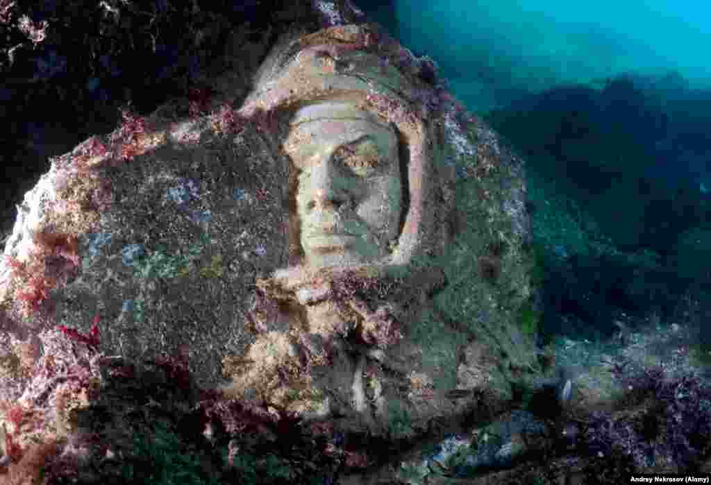"Gagarin again. Nekrasov says, ""It it is difficult to say now exactly if it was irony or nostalgia that motivated the founder of the underwater museum."""