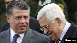 Mahmud Abbas (right) speaks with Jordan's King Abdullah II during a welcoming ceremony in the West Bank city of Ramallah last November.