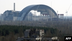 The first half of the Chernobyl New Safe Confinement, an arch that which will cover the reactor building, is seen after it was pushed to its site at the Chornobyl nuclear power plant in April 2014.