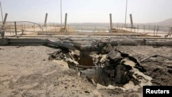آثار إنفجار في مدخل سد الموصل