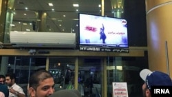 Anonymous hackers hacked the Mashad airport's screens for an hour on Thursday night May 24, 2018. The screen shows image of an anti-hijab protester.
