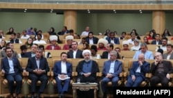 Iranian President Hassan Rohani (C) attends an event marking government achievements in rural areas, in the capital Tehran, August 26, 2019