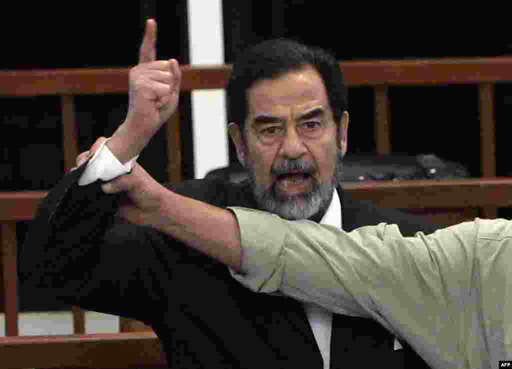 Saddam Hussein responds after receiving the death sentence in the Al-Dujayl trial, November 5, 2006. On December 26, an appeals court upheld the sentence.