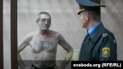 "Yury Rubtsou displays a tattoo on his chest saying ""Lukashenka, get out!"" during his trial in Pruzhany, Belarus."