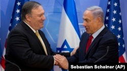 U.S. Secretary of State Mike Pompeo (left) shakes hands with Israeli Prime Minister Benjamin Netanyahu during a meeting in Jerusalem in March.
