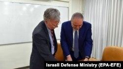 ISRAEL -- Israeli Defense Minister AVigdor Lieberman (R) shows a map to US. national security adviser John Bolton in Jerusalem, August 20, 2018