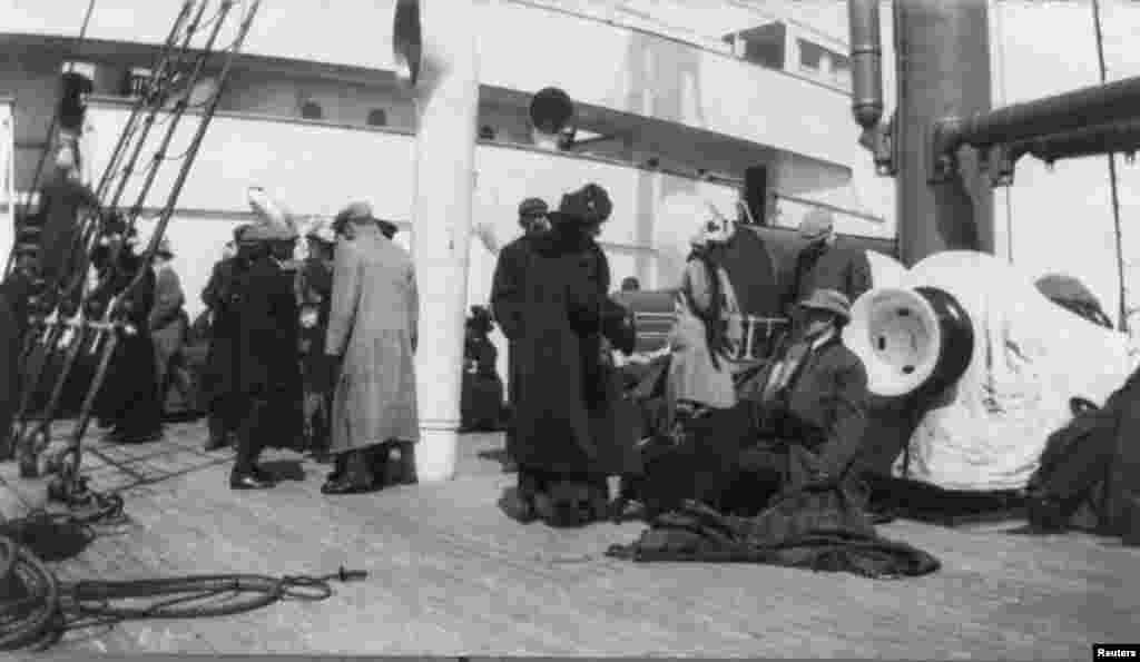 "A group of survivors from the ""Titanic"" disaster aboard the ""Carpathia"" after being rescued."