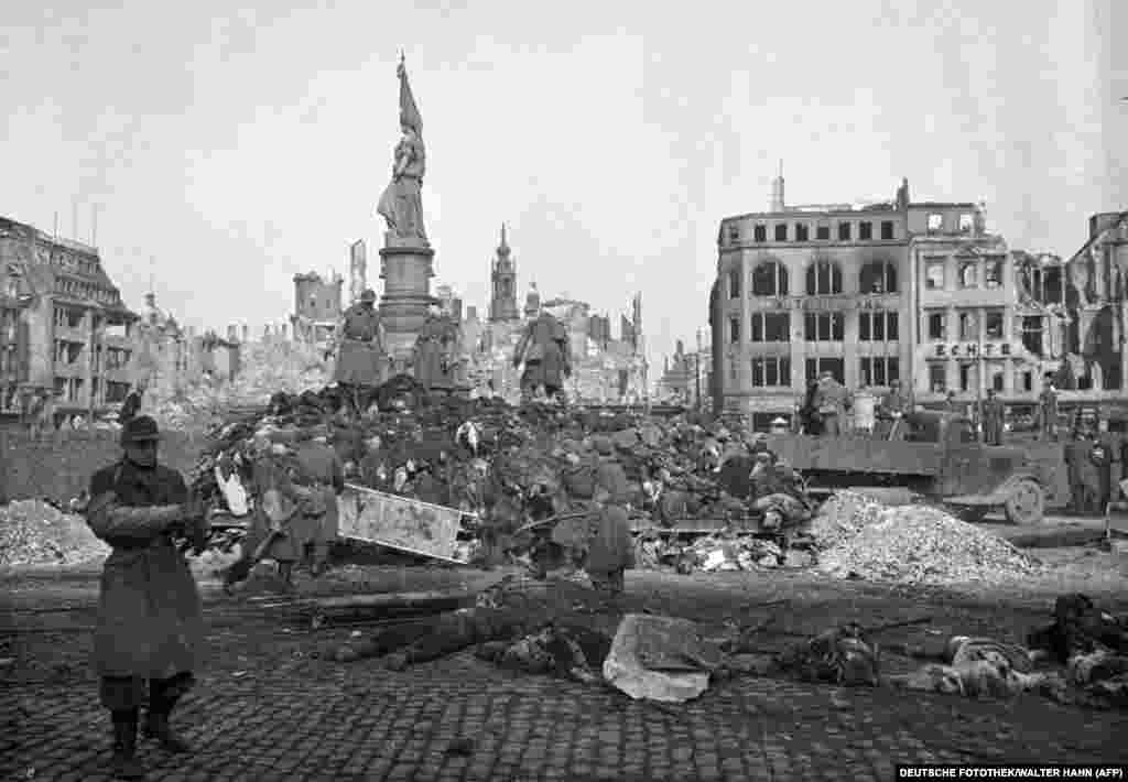 A pile of bodies before they were publicly cremated. Some 25,000 people were killed during the bomb attacks on Dresden, many incinerated in a firestorm so powerful people were literally sucked down streets and into the inferno.