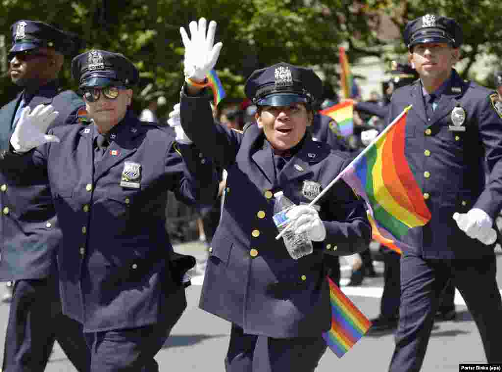 New York City Police Department officers march during the annual New York Pride parade on June 25. (epa/Porter Binks)