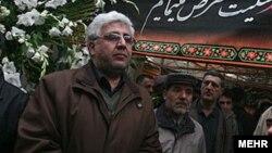 فرهاد رهبر، رئیس دانشگاه تهران (چپ).