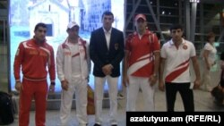 Armenia -- Armenian Olympic athletes pictured at Yerevan airport before leaving for London, 25Jul2012.