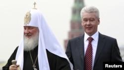 Патриарх Кирилл белән Собянин
