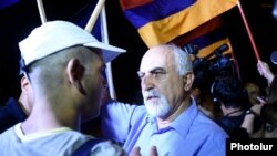Armenia - Paruyr Hayrikian (R) argues with a protester on Marshal Bagramian Avenue, Yerevan, 2Jul2015.