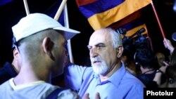 Armenia - Paruyr Hayrikian (R) argues with a protester on Marshal Bagramian Avenue, Yerevan, 2Jul2015.