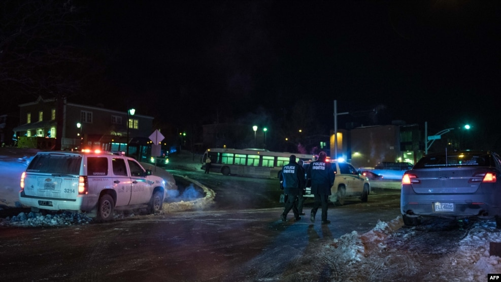 Canadian police respond to a shooting in a mosque at the Quebec City Islamic cultural center on January 29.
