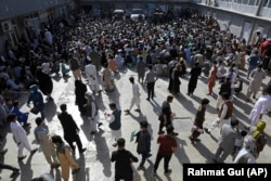 A passport office in Kabul inundated with applicants on June 30.
